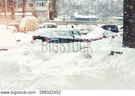 Apartment Or Office Building Parking Lot With Many Cars Covered By Snow Stucked After Heavy Blizzard