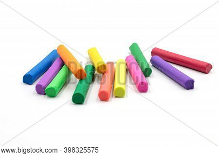 Isolated Multi Colors Of Plasticine Sticks On White Background