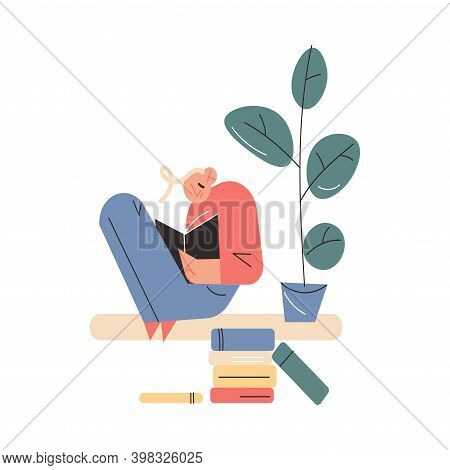 Smiling Young Boy Sitting On Windowsill With Book And Reading At Home