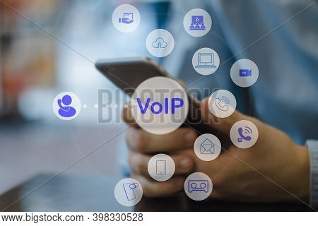 People Using Ip Phone / Smartphone With Flying Icon Of Voip Services And People Connection, Smart Vo