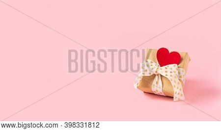 Gift Or Present Box With Red Heart On Pink Background. Pastel Colors, Copy Space For Text And Design