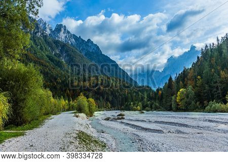 Travel to fabulous Slovenia, Julian Alps. Great Pysnitsa Stream. The shores of Lake Jasne. The famous Triglav Park. The mountains are overgrown with dense mixed forest