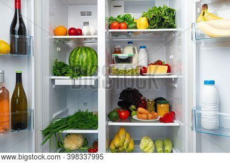 Open Fridge Full Of Fruits, Vegetables And Drinks