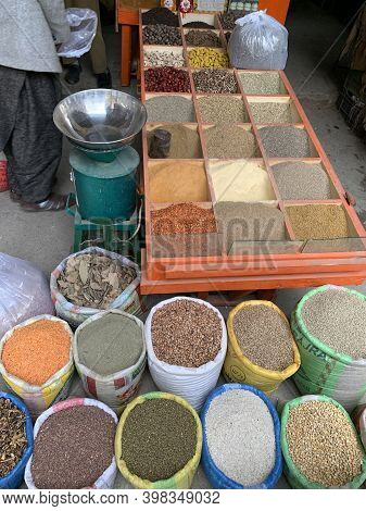 Different Spices In The Bags And Wooden Boxes At The Shop At The Bazar In Pakistan