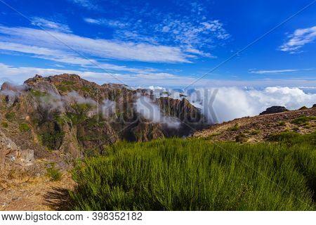 Hiking Pico do Arierio and Pico Ruivo - Madeira Portugal - travel background