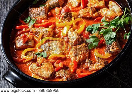 Moqueca Baiana - Brazilian Fish Stew Of White Fish With Sweet Pepper, Lime Juice, Chopped Tomatoes,