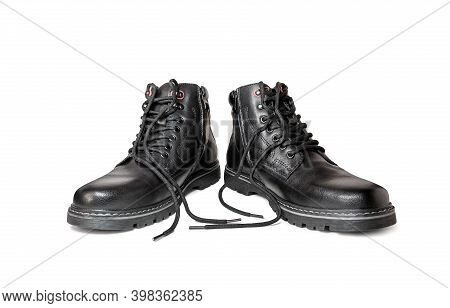 Black Boots Made Of Genuine Leather With Untied Laces. Men's Winter Shoes On A White Background.