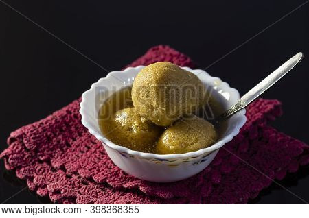 The Most Famous Bengali Or Indian Sweets - Rasgulla Made With Date Palm Jaggery Or Nolen Gur In A Bo