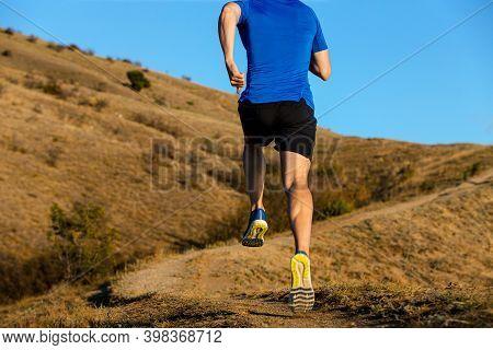 Back Man Runner Running Mountain Trail On Background Blue Sky