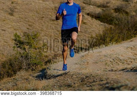 Male Athlete Runner Run Uphill. Mountain Trail Training