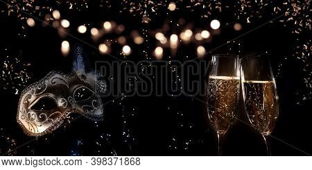 Champagne For New Year And Carnival Greetings. Abstract Dark Bokeh Background With Champagne Glasses