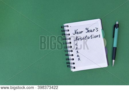 New Years Resolutions Concept. New Years Resolutions On A Green Background. Flat Lay.