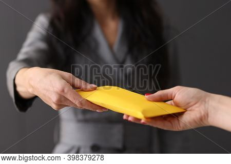 Womans Hand Giving Envelope To Another Woman Concept. Corruption And Bribery In Business Concept