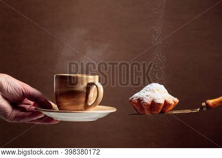 Muffin Sprinkled With Sugar Powder. Muffin And Brown Cup With Hot Coffee Or Tea. Copy Space.