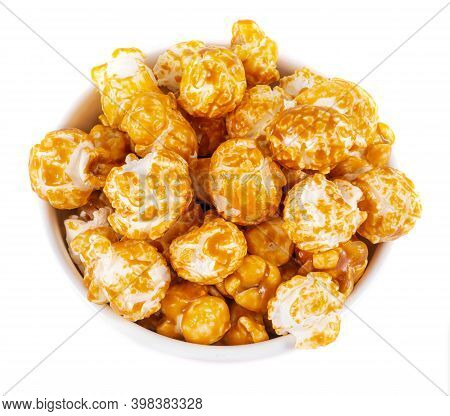 Sweet Caramel Candy Popcorn In A Bowl Top View White Background
