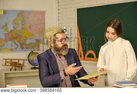 Bearded Man Teacher In Classroom. Teacher Checking Right Answer. Track Student Progress. Teaching Ma