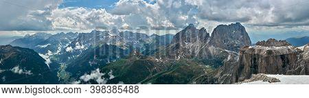 Panorama Of Dolomites From Sass Pordoi, Italy. View Of Sassolungo, Sassopiatto And Sella Mountain Ma