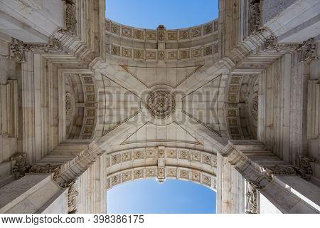Looking Up View Of Triumphal Arch Arco Da Rua Augusta In Lisbon, Portugal