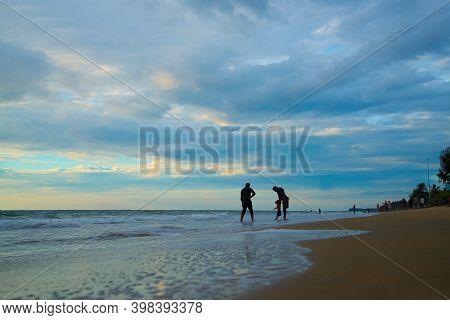 Kerala, India - 03 December 2020: Family Enjoying Holidays On Beach, Cherai Beach Kerala India