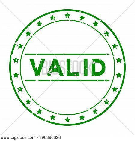 Grunge Green Valid Word With Star Icon Round Rubber Seal Stamp On White Background