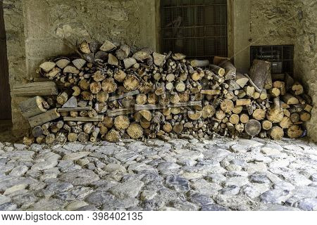 Pile Of Firewood Under A Porch In The Mountains.