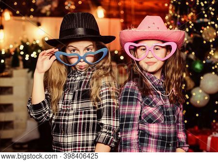 Our Traditions. Little Girl Sisters In Red Hats. We Are Family. Elf Children. Xmas Tree. Santa Claus