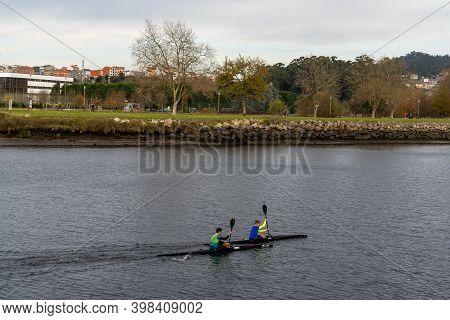 Pontevedra, Galicia / Spain - 2 December 2020: University Students During Rowing Training On The Pon