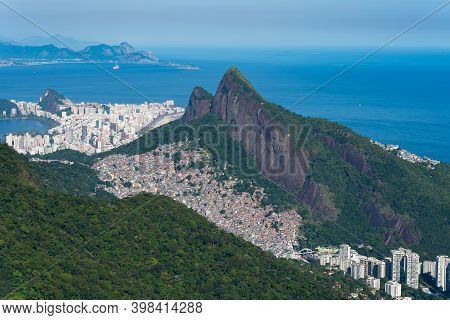 Aerial View Of Favela Rocinha, The Largest In Latin America, Located On The Mountain In Rio De Janei