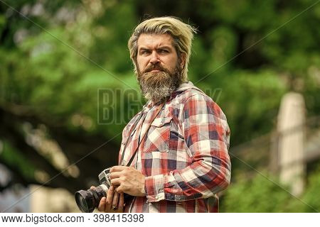 Man Bearded Hipster Photographer Hold Vintage Camera. Man With Beard Shooting Photos. Content Creato