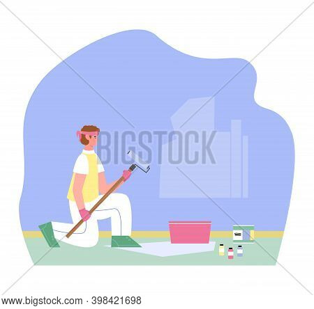 Craftsman, House Painter Or Handyman Is Painting Wall Blue Color. Man With Roller And Paints Is Enga