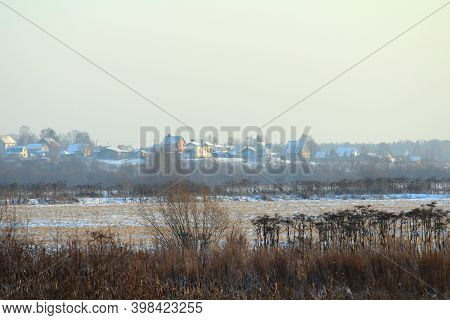 Foggy Winter Landscape With Bushes And Trees On Silhouettes Of With Village And City Houses Backgrou