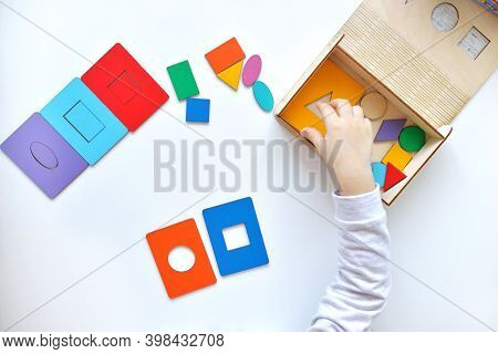 Learning Colors And Shapes. Children's Wooden Toy. The Child Collects A Sorter. Educational Logic To