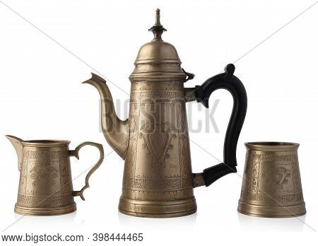 Brass Crockery Isolated On White Background. A Set Of Teapot And Cups.