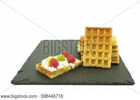 Delicious Biscuit And Corrugated Waffles On A White Plate. Homemade Waffles And Belgian Waffles. Vie