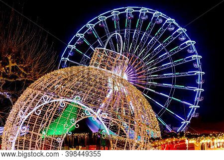 Giant Christmas Ball And Ferris Wheel. Christmas Fair In Maastricht, Netherlands. New Year Decoratio
