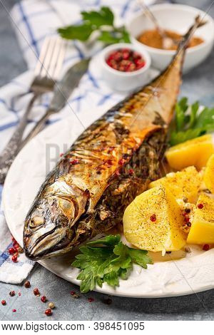 Baked Mackerel Stuffed With Herbs With Tarragon And Pepper, Served With Parsley And Boiled Potatoes