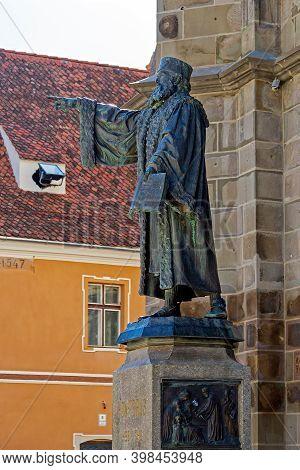 Brasov, Transylvania, Romania-july 11, 2020: Statue Of Johannes Honterus,1498-1549,near The Wall Of