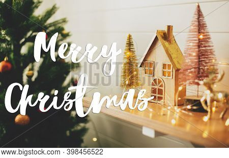 Merry Christmas Greeting Card. Merry Christmas Text Handwritten On Stylish Christmas  House, Glitter