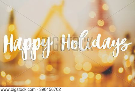 Happy Holidays Greeting Card. Happy Holidays Text Handwritten On Abstract Holiday Background, Blurre