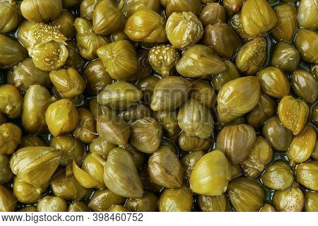 Pickled Capers As A Background. Marinated Buds Of Caper Bush. Mediterranean Cuisine Ingredient. Orga