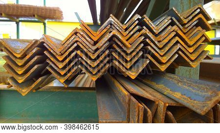Rusty Steel Corner In Row. Industrial Supplier. Warehouse Of Metal Building Materials. Construction