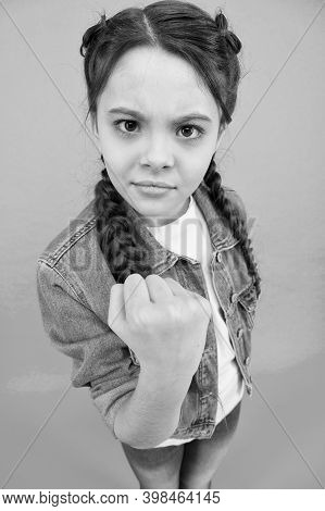 Threatening With Fist. Angry Child Shake Fist Grey Background. Beauty Look Of Child Girl. Small Chil