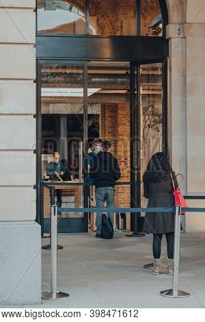 London, Uk - November 19, 2020: People Picking Up Orders Outside Apple Store In Covent Garden, Staff