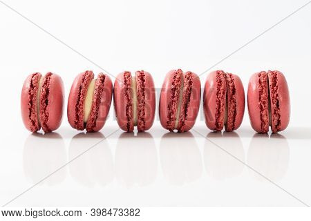Traditional French Red Color Macarons In A Rows, Strawberry Favor