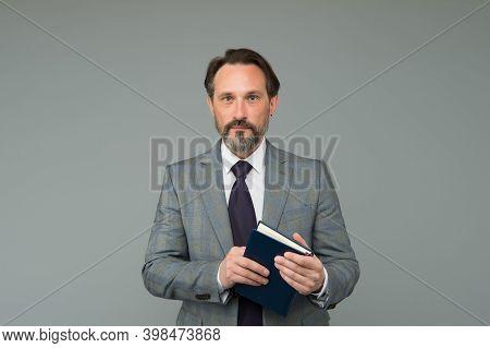 Making Business Notes. Bearded Man Hold Book. University Teacher In Formalwear. Mature Man Grey Back
