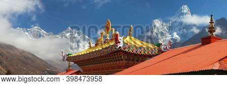 Red Roof Of Tengboche Monastery Entrance And Mounts Ama Dablam, Everest And Lhotse, Khumbu Valley, S