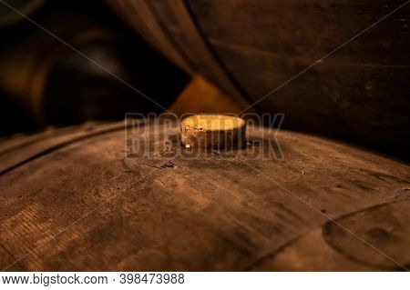 Cork Close Up, Old Porto Lodge With Rows Of Oak Wooden Casks For Slow Aging Of Fortified Ruby Or Taw