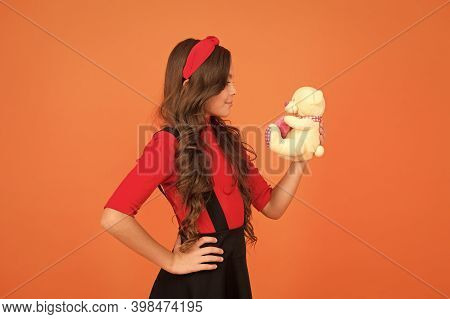 Toy Is Me. Little Kid Hold Teddy Bear Brown Background. Small Kid Play With Soft Toy. Kid Gift Or Pr