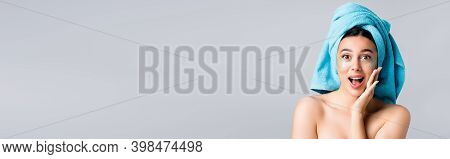 Amazed Beautiful Woman With Blue Towel On Hair And Hydrogel Eye Patches On Face Isolated On Grey, Ba