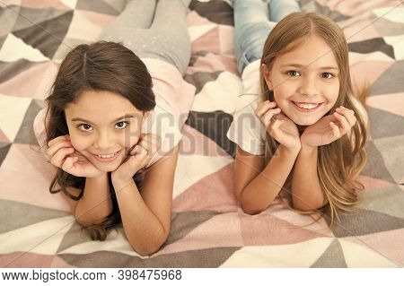 There Are Many Reasons To Be Happy. Happy Kids With Cute Smiles. Small Children Relax On Bed. Enjoyi